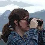 image of woman with binoculars